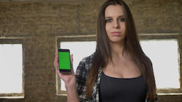 Young beautiful attractive women with long hair showing something on her phone Footage