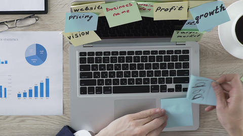 Entrepreneur sticking idea note on laptop, developing startup business strategy Footage
