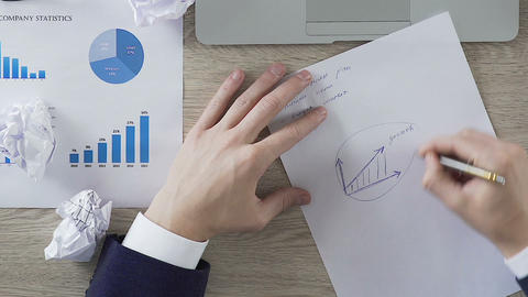 Entrepreneur circling growth graph on paper, firm profit, setting business goal Footage