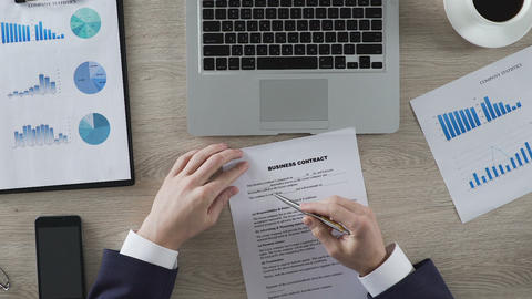 Man reading terms and conditions of business contract, signing it, new agreement Live Action