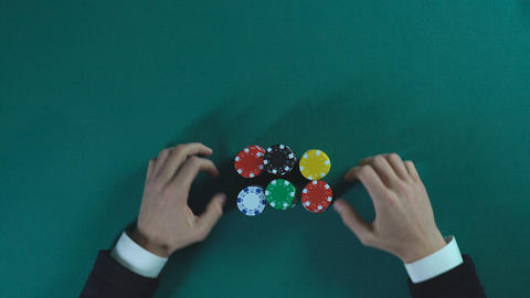 Businessman betting all-in in poker game, risky decision, cunning and bluff Live Action