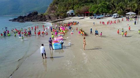 preschool children run to ocean from beach Footage