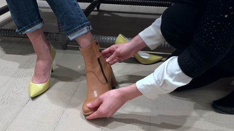 Close Up Of Female Shoes And Feet in Luxury Shop Footage