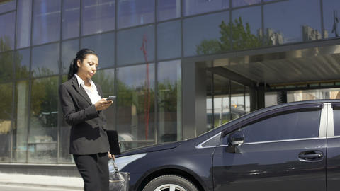 Prosperous woman lawyer going home after successful completion of case in court Footage