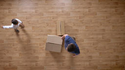 Young father and son moving into empty house with boxes, top shot, little boy Footage