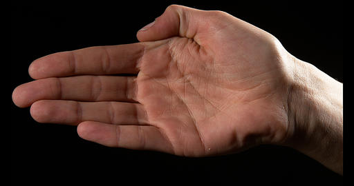 Hand of Woman against Black Background, Slow Motion 4K Live Action