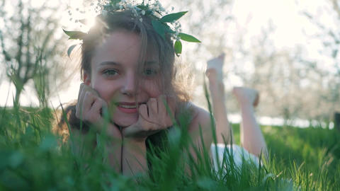 Beauty Smiling Girl lying on the Spring Meadow with wild... Stock Video Footage