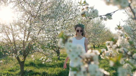 Beauty young woman enjoying nature in spring apple orchard, Happy Beautiful girl 영상물