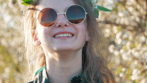 Smiling Young Woman Puts on Sunglasses. Slow Motion Stock Video Footage