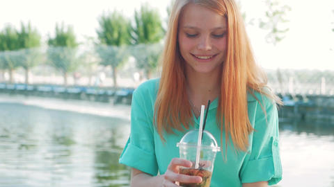 Beautiful young woman with lemonade and red hair Footage