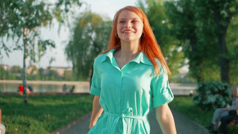 Beauty girl with red hair and colorful air balloons spinning and laughing, on Footage