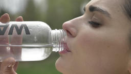 Young confident girl sportsman drinks water outside,... Stock Video Footage