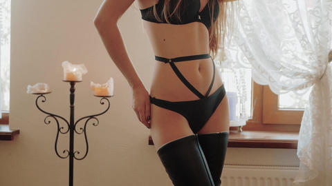 Hot Sexy beautiful Sensual blonde woman with perfect slim body posing in black Footage