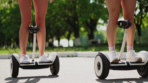 Close - up of female legs in short shorts on self-balancing scooter Live Action