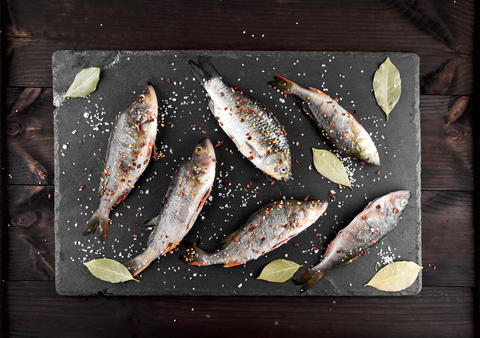 scraped river fish crucian and perch in spices and salt \ Photo