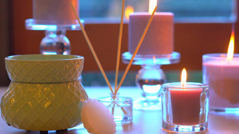 Aromatherapy table setting with perfumed candles, oil burner and mood reeds in Footage