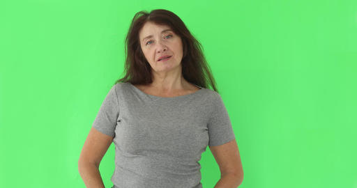 Serious wise woman looking at camera on chromakey Footage
