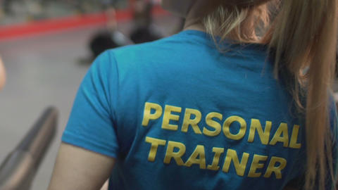 Personal trainer cheering her trainee in gym, teamwork and cooperation, support Live Action