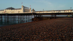 Drone flies very slowly and low sideways past Brighton Pier Footage