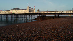 Drone flies very slowly and low backwards from Brighton Pier Footage