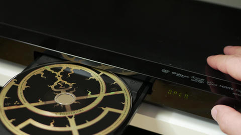 Putting disk in blu-ray player, DVD, audio CD, SACD Footage
