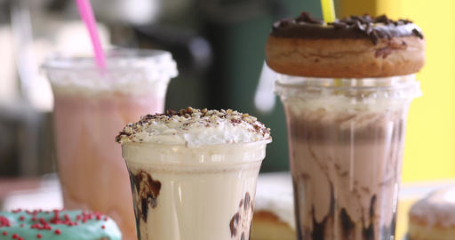 Milkshakes with donuts for takeaway in a cafe Live Action
