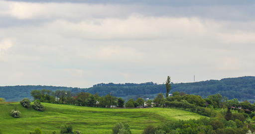 Idyllic rural view of gently rolling patchwork farmland Live Action