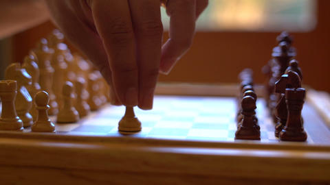 Chess game start, dolly slider, in natural window light, shallow DOF Footage