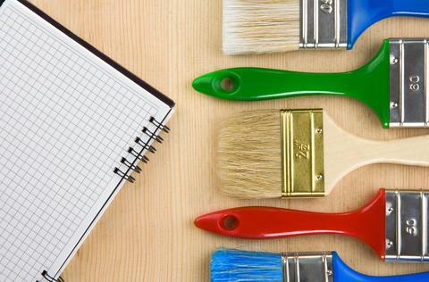 colorful paintbrush on wood Photo