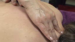 Masseuse press two on backbone of young woman. Therapeutic professional massage Footage