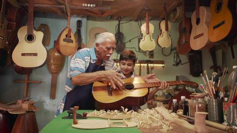 13-Boy Learns Play Guitar With Senior Man Grandpa GIF 動畫