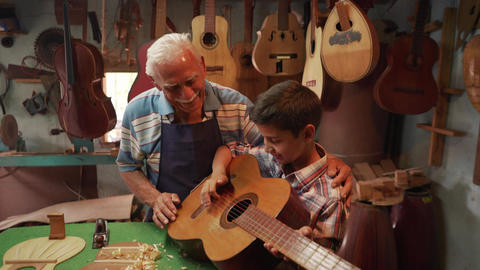 15-Boy Learns Play Guitar With Old Man Grandpa Footage