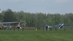 Aeroprakt A-22 and Yakovlev-52 light aircrafts at parking Live Action