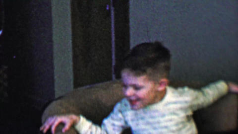 1957: Kids spinning rotating living room home chair getting dizzy Footage