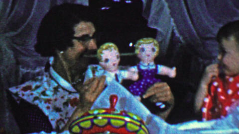 1957: Mom shows cautious baby creepy sibling twin toy dolls Footage