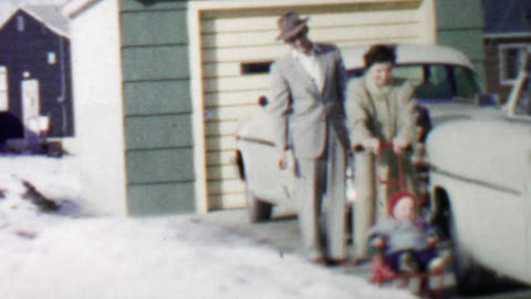 1957: Family baby cart red sled wheels pushing happy baby stroller Footage