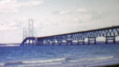 1957: Modern steel bridge over shallow blue water beach Footage