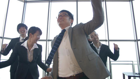 A Japanese Boss and his team let loose and dance at the office SLOWMO Footage