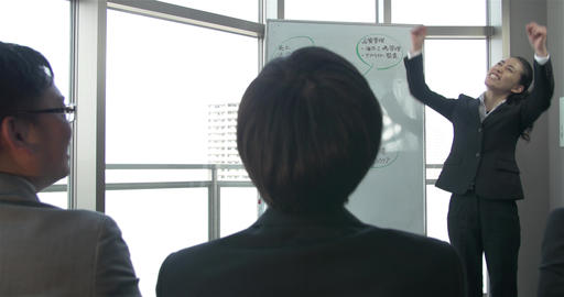 Energetic Japanese business women pumps up the team before a bog meeting ライブ動画