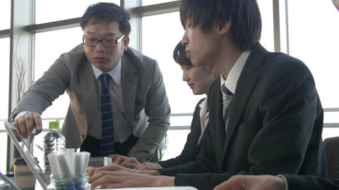 Japanese boss enjoys giving tasks to his team slow motion Footage