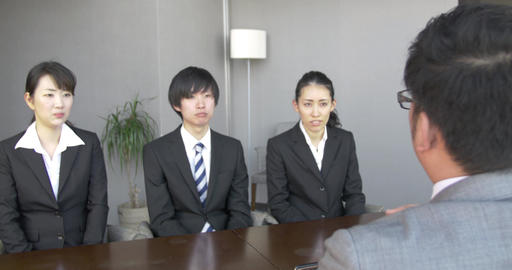 Japanese boss explaining processes at a job interview Footage