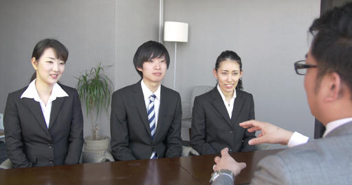 Japanese boss talking to new employees about his company Footage