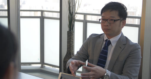 Japanese business man explains business concepts to… Stock Video Footage