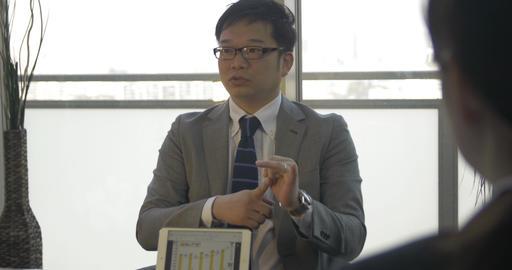 Japanese Business man explains number graph tp job candidates Footage