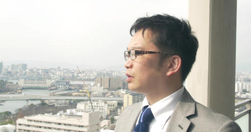 Japanese Businessman Looks Over The City stock footage