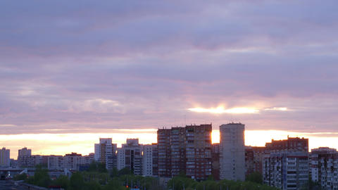 City during warm sunset. Background with sunset skyline. City evening timelapse Footage