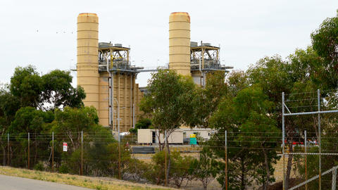 Gas fired electricity power station in remote industrial area, 4k handheld Footage