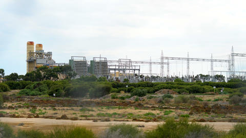 Electricity power station in remote industrial area and high voltage power Footage