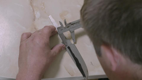 Workman measuring handmade knife, DIY do it yourself. Close up of man making Footage