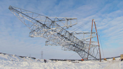 workers install high voltage line support pulling by mechanisms Footage